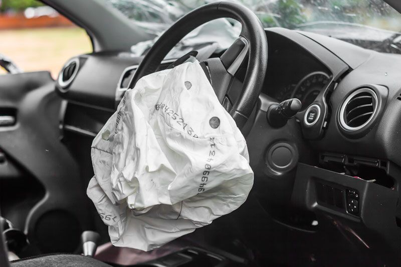 car with airbags deployed, auto insurance claim mistakes