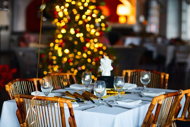 table decorated for the holidays, plan an amazing holiday party