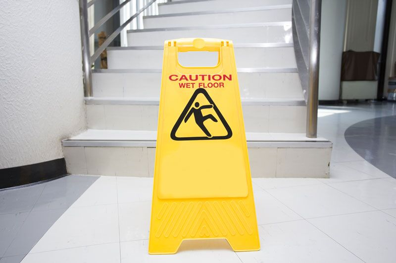 wet floor warning sign, making your business safer
