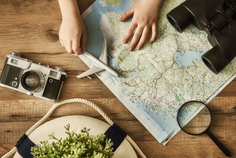 map on table, why it's best to plan your summer vacation in winter